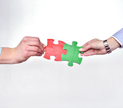 group-of-business-people-assembling-jigsaw-puzzle