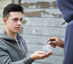 teenage-boy-buying-drugs-on-the-street-from-dealer